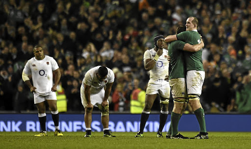 Giant slayers: Ireland's Iain Henderson and Devin Toner celebrate as England's Maro Itoje and Mako Vunipola look dejected at the end of the match. Picture: REUTERS