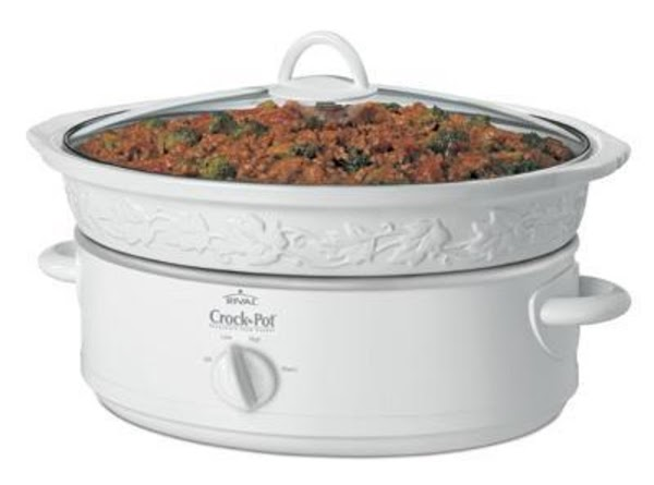 Coat crock pot with non-stick cooking spray.  Add meatballs.
