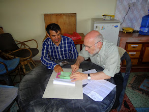Photo: Here brother Merle is looking over the expense record of the conference with Pastor Anand. MTM pays up to 80% of the conference costs so all pastors have the blessed opportunity to receive the teaching.