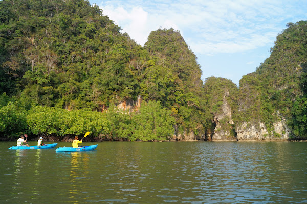 Paddle on a sit-on-top kayak through Ao Thalane Bay
