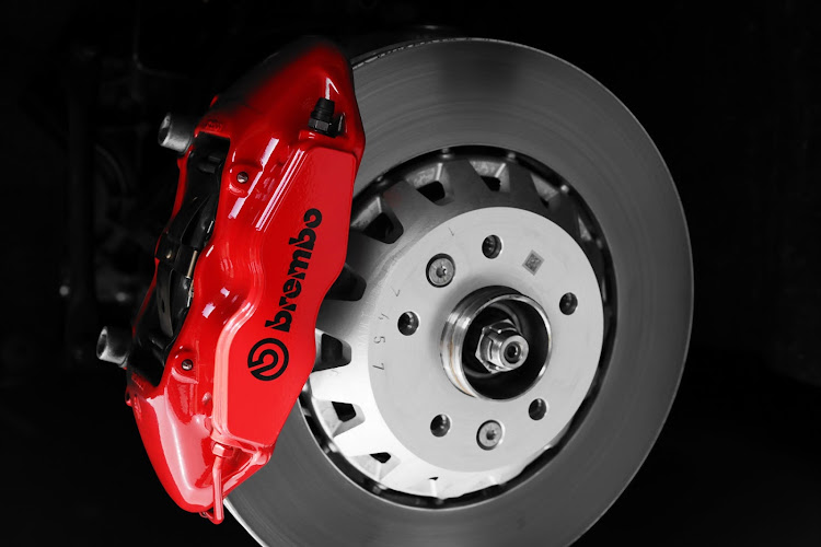 Front brakes feature bi-material brakes with Red Brembo calipers.