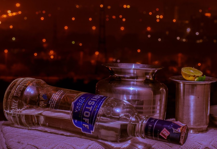 vodka in the midst of thunderstorm and rain... by Hemant Shukla - Food & Drink Alcohol & Drinks ( silver glass, vodka )