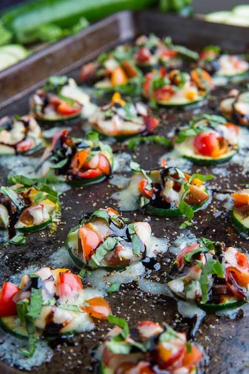 "Zucchini Bruschetta Bites""Tomato bruschetta on bite sized slices of zucchini topped with..."