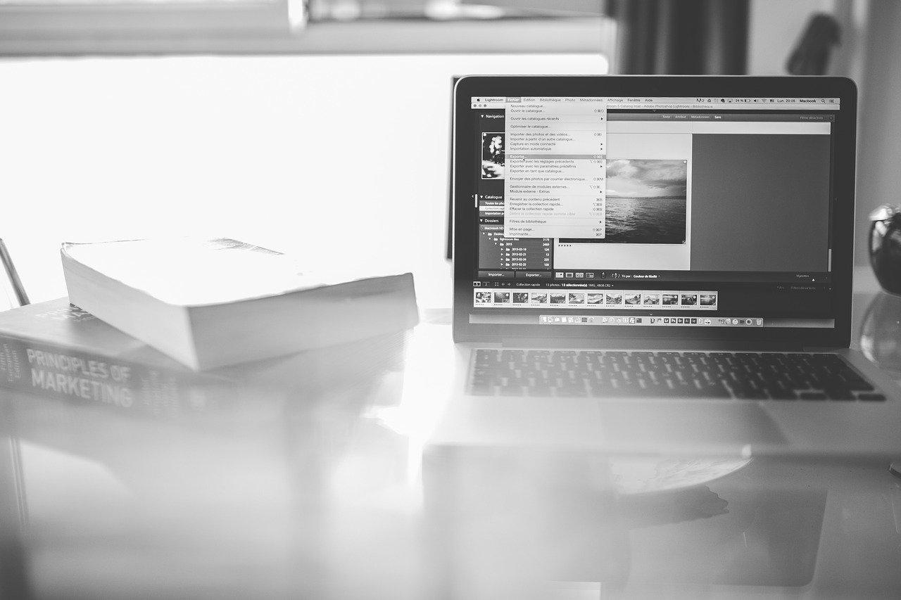black and white photo of laptop