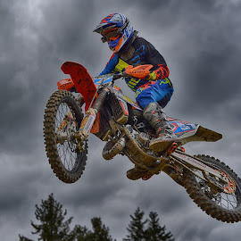 Area 51 by Marco Bertamé - Sports & Fitness Motorsports ( clouds, orange, speed, number, race, noise, jump, flying, red, motocross, blue, 51, grey, air, high, overflying )