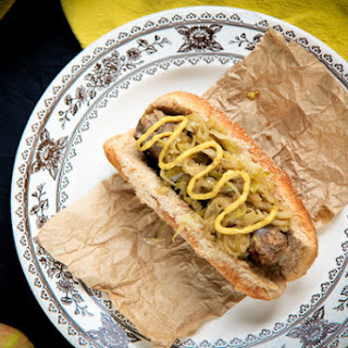 Beer-Braised Brats with Quick Apple and Onion Sauerkraut