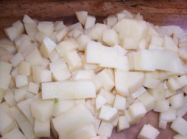 Add minced garlic, diced potatoes, water (should cover the potatoes) rosemary sprig, bay leaf,...