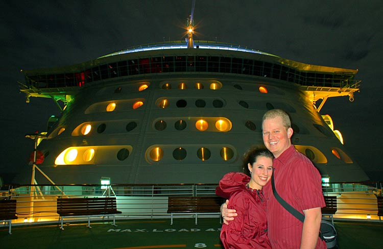 Passengers pose on the bow of Independence of the Seas.