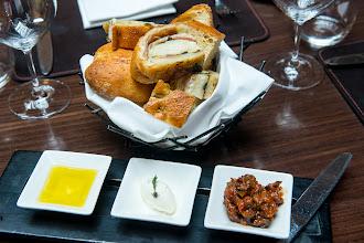 Photo: Warm cheese-and-salami stromboli, housemade focaccia and ciabatta from Sullivan Street Bakery at Scarpetta