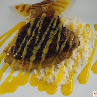 Jerk Chicken with Coconut Rice and Mango Sauce.