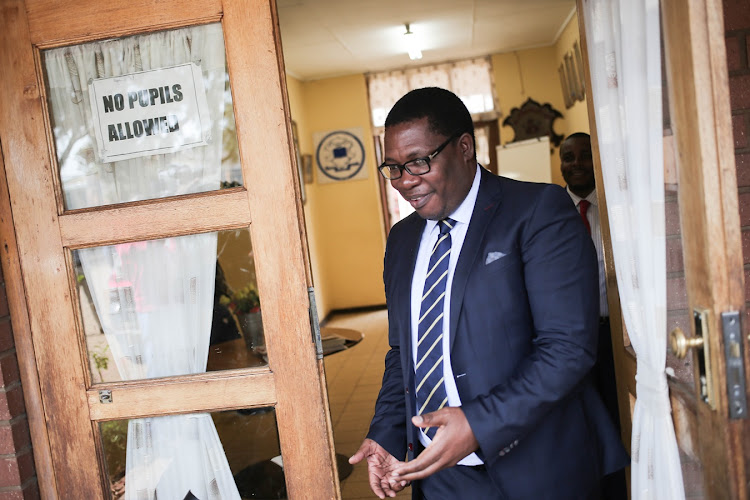 Gauteng Education MEC Panyaza Lesufi exits the Klipspruit West Secondary School in Soweto, Johannesburg, after meeting with management on Tuesday.