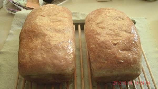 Two Loaves Of Honey Butter Coated Fluffy White Bread Two Minutes Out Of The Oven. Nummy!
