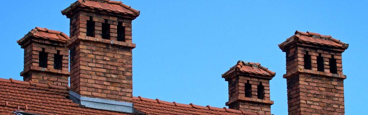 Face-brick chimneys on top of an old house