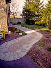 Photo: Old stone was salvaged and mixed with this new soldier row and pulled OUT into the driveway, helping it blend into the landscape.