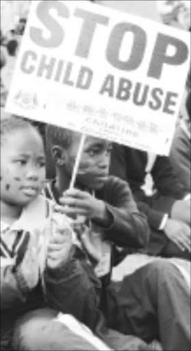 LOUD AND CLEAR: Kids protest against abuse. Pic. Elijar Mushiana. 10/08/2009. © Sowetan.