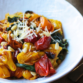 Spaghetti Squash with Tomato, Spinach, Garlic and Pine Nuts.