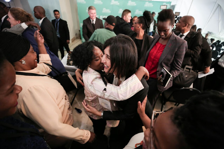 Legal representative for Section 27, Advocate Adila Hassim, celebrates with the relatives of the Life Esidimeni victims after Former Deputy Chief Justice Dikgang Moseneke ordered that the government pay R1.2 million to the families at the hearings in Parktown, Johannesburg on 19 March 2018.