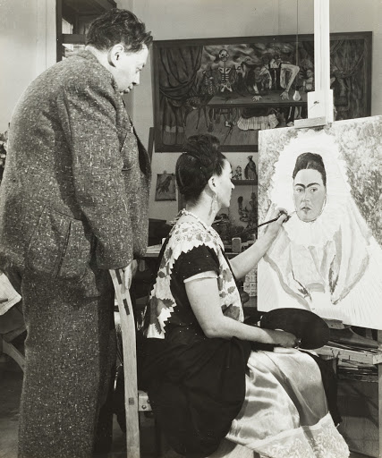 Diego Rivera Watching Frida Kahlo Paint a Self Portrait
