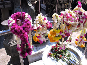 Photo: Garlands and flower offerings are hung in front of a statue of the goddess Kwan Yin, Wat Phra Kaew