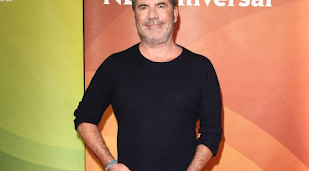 Simon Cowell keen to work with Robbie Williams