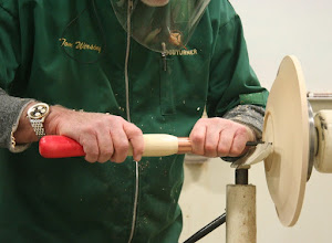 Photo: His chuck has dovetailed jaws, and he has a scraper shaped to make a cut of just the right angle.