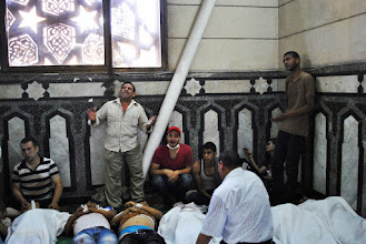 Photo: Mourners gather inside Al Fat'h Mosque after deadly clashes break out during Friday's 'Day of Rage' protest. At least 95 people are reported killed in the clashes. Cairo, EGYPT - 16/8/2013. Credit: Ali Mustafa/SIPA Press