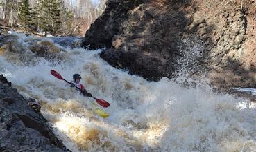 Photo: Kayaker Tony Locken of Chaska, Minn., makes his way down one of the rapids on the Lester River as spectators look on.