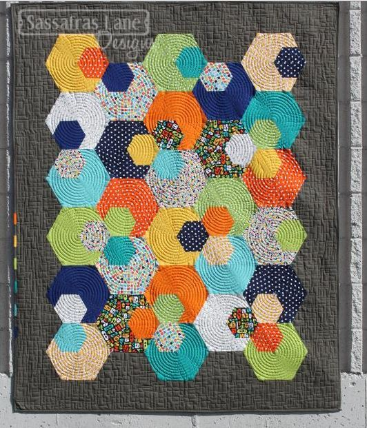 Grey Quilt with Multicolored Geometric Pieces