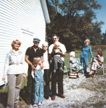 Photo: Leigh Henson family at the Webb Cemetery, 1979. Left to right: Sandra Henson, Darold with Kendra Henson, Ruth Webb Henson, and Leigh with Brandon Henson. Not sure of the names of the ladies in the background.