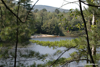 Photo: Spectacle Pond through the trees, Brighton State Park