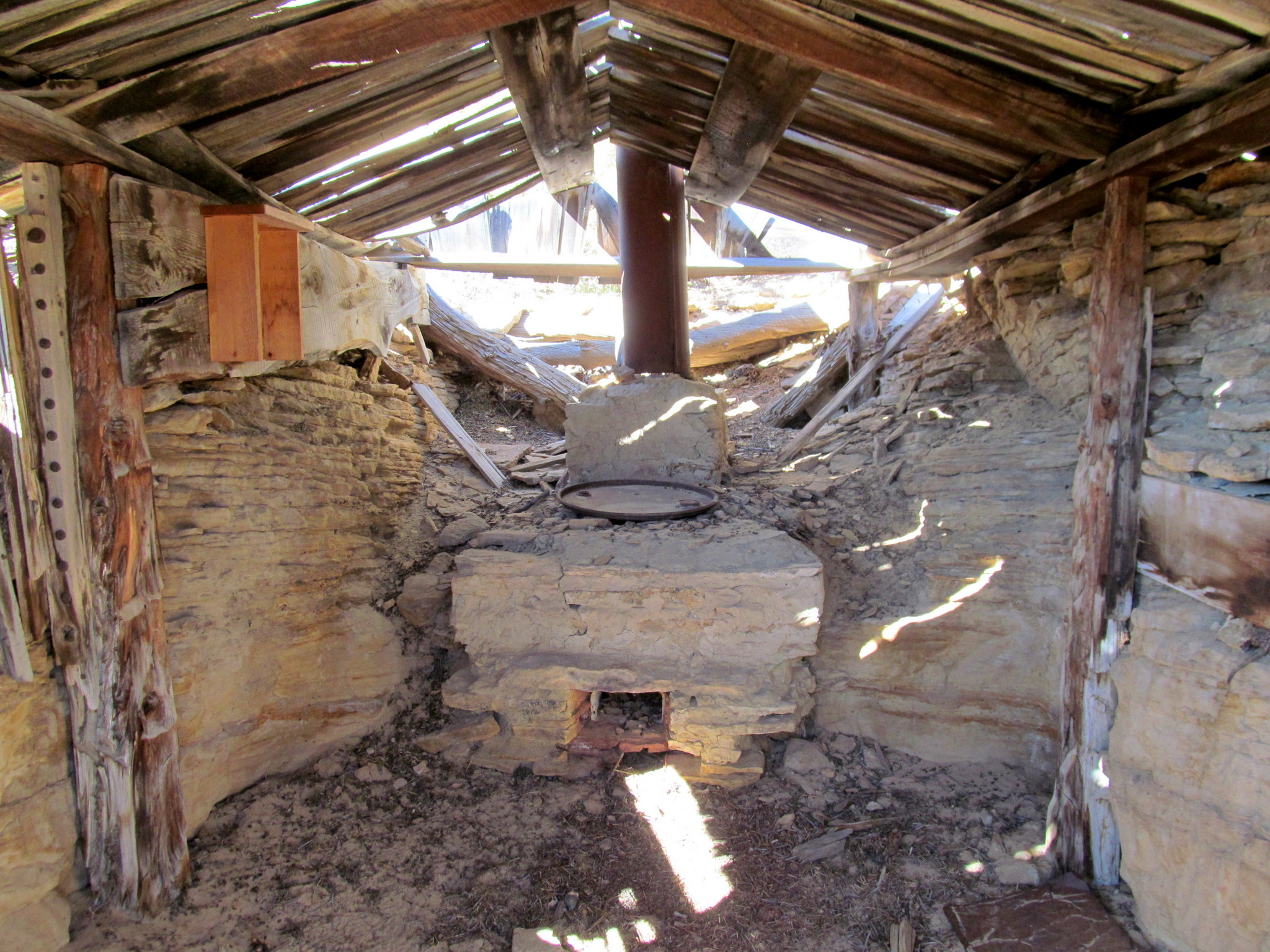 Photo: Partial dugout cabin with oven