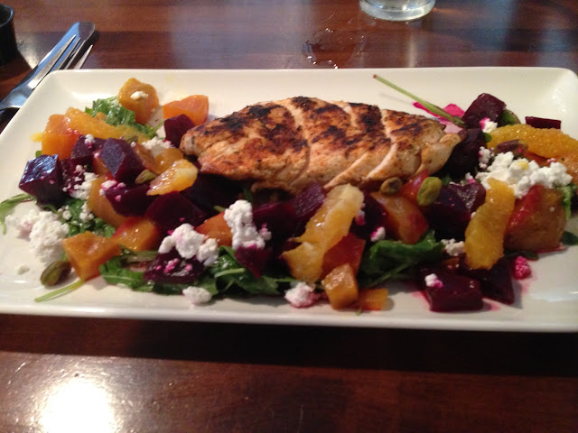 Blackened chicken beet salad with arugula, pistachios, mandarin oranges, and goat cheese
