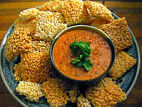 Photo: platter of crispy rice crackers with savory peanut-coconut dip
