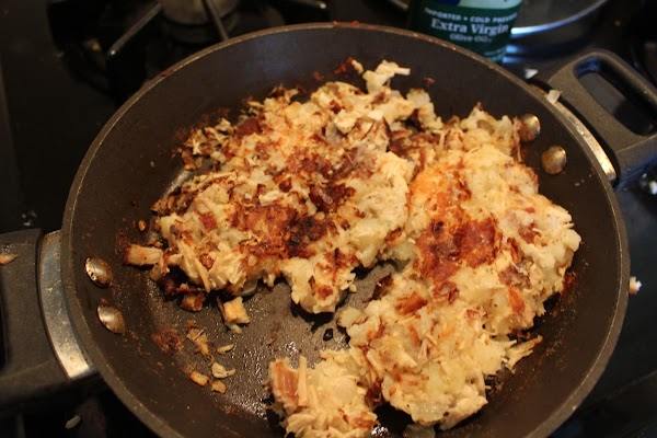 Scrape up the hash from the bottom of the pan and turn it over,...