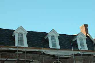 Photo: February 2006 - Month 30: Front roof and dormers completed. Beautifully reset masonry crown and lovely new gutters!