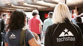 People wearing techstars shirts walking