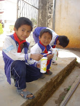 Photo: Boys from the Yunnan Province brushing their teeth with their new toothbrushes and toothpaste