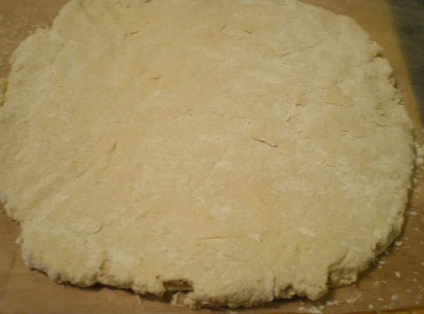 Roll the biscuit dough to just shy of the length of your bread pan...