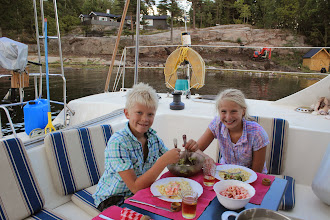 Photo: Dinner-time! Our old cottage now painted grey in the background. Many trees have been cut and the boat-house repaired.