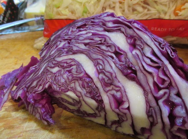 Cut a wedge of red cabbage from a small cabbage, then finely shred it...