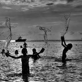 Water girls by Brandon Chapman - People Street & Candids ( water, playing, girls, grand cayman, sea, ocean, kids, fun, people, sun, splash, water drop ,  )