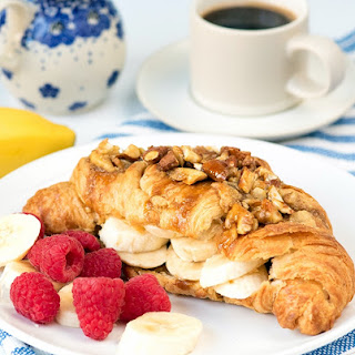 Sticky Banana Croissants with Crushed Nuts.