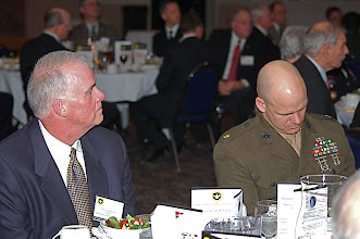 Photo: Business leaders participating in the National Security Roundtable Program on March 17 sit with their CGSS student escorts during the program dinner March 16 at Fort Leavenworth's Frontier Conference Center. The CGSC Foundation sponsors the Roundtable program and the CGSC Commandant and Deputy Commandant host it. Chief of Staff of the Army Gen. George W. Casey, Jr., was the special guest speaker at the dinner.
