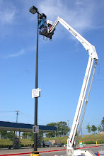"""Photo: Man-Lift changing Light Bulbs in Parking Lot of -Wal-Mart SC -New Troop Hwy -July 9th 2009 -Tour de France in Effect Mode with LOUD SCREAMIMG SIRENS from NEAL 'FRANK PUS IN THE KNEE"""" FRANK Tyler PD Chief On My Jock Like Static Cling and On My Jock like a Bunch of Little Ho Bitches-Subouring- Police Misconduct and Passing Messges Via Phil Liggete and Paul Sherwen and Verus Network-Suddenlink Cable -Tyler, TX -They KNow in The ENITRE Pro PELTON That Levi Leiphimer Only Recongized his Broken wrist Team Astana from TISSUE DAMAGE via Pain Fibers(NOCIOCEPTION and he Twiitered his Wrist Surgey ( Showing The Schaphiod Wrist Bone and a Regional Anesthtic Nerve Block was used to prevent pain while Levi was awake which was sent out to VERSUS and The Media pololiirinnsmi"""