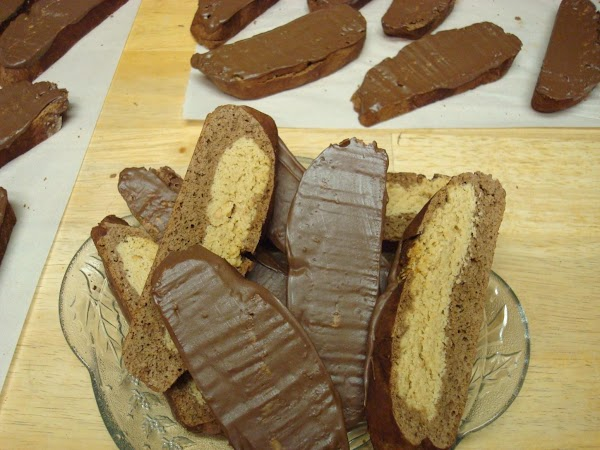 Melt coating chocolate according to package directions. Coat one side of cooled biscotti with...