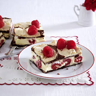Crispy Meringue Wafers With Raspberry Cream.