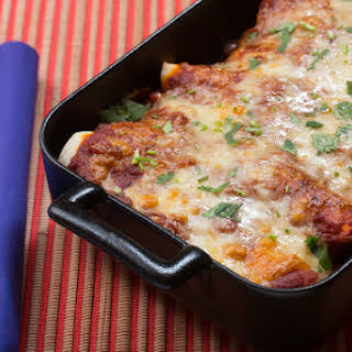 Cheesy Enchiladas Rojas with Mixed Mushrooms & Spinach.
