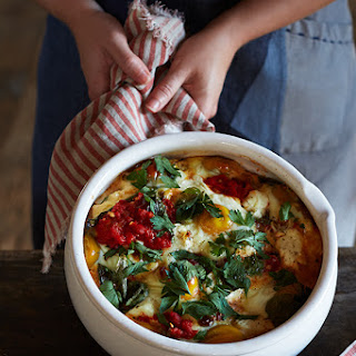 Baked Eggs with Harissa & Goat Cheese