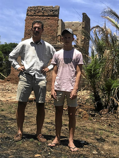 Ben Freeth and his son Stephen at the ruins of their farm in Chegutu, from which they were evicted in 2009.