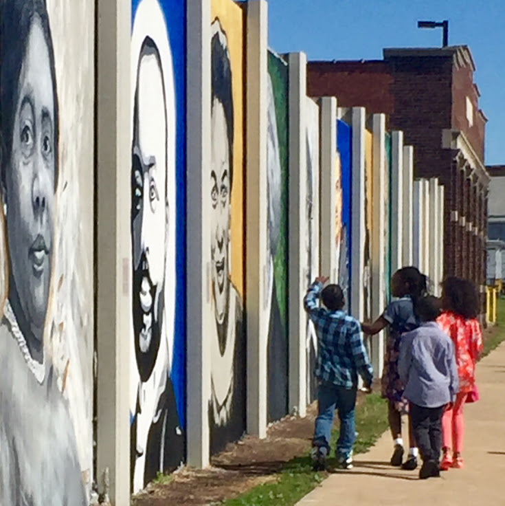 Kids walk past the Freedom Wall. Photo: mjaepeterson.
